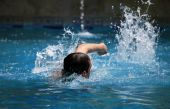 stock photo of swim meet  - Swimming freestyle in waterpool with blue water - JPG