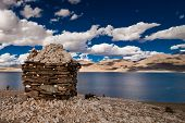 foto of nomads  - Sunset at Tso Moriri Lake with Buddhist stupa made by nomad Tibetan people - JPG