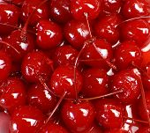 Festive Background Of Red Cocktail Maraschino Cherries With Stems