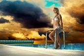 Beautiful happiness girl in white bikini stay near the waterpool