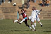 BLOEMFONTEIN, SOUTH AFRICA - AUGUST 7: Unidentified players during a men's soccer match between the North West and Free State Universities, on Aug 7, 2010 in Bloemfontein, South Africa.
