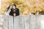 Young Couple By The Fence