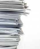 Closeup Stack Of Papers Isolated On White.