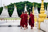 Buddhist monks walking at the pagoda