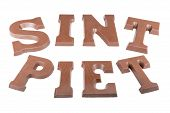 Chocolate Letters Making The Word 'sint'  And