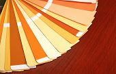 Open Pantone Sample Colors Catalogue On Wood Background