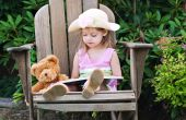 Child Reading To Bear