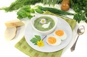Fresh Herbs Soup With A Dollop Of Cream