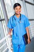 attractive female african american medical doctor holding clipboard