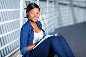 happy african american college student with books