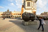 KRAKOW, POLAND - FEB 28, 2014: Igor Mitoraj's sculpture Eros Bendato (Eros Tied) 1999 on main square
