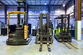 pic of forklift driver  - Three forklift in the large modern warehouse - JPG