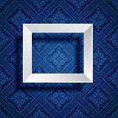 white empty frame on blue baroque wallpaper