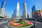 Shanghai street view with skyscrapers, roundabout and blue sky.
