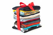 picture of gift basket  - stack of clothing with red ribbon and bow like a gift - JPG