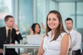 Smiling girl sitting in modern corporate environment