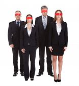 Group Of Businesspeople's Eyes Covered With Ribbon