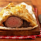 picture of beef wellington  - Fillet Wellington in puff pastry on wooden table - JPG