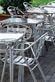 aluminum tables and chairs in a cafe on the street