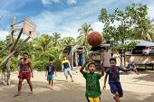 El NIDO, PHILIPPINES - JAN 11: Kids and teenagers are playing basketball in a small and poor village