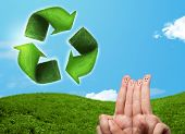 Happy cheerful smiley fingers looking at green leaf recycle sign