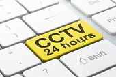 Protection concept: CCTV 24 hours on computer keyboard background