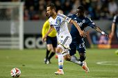 CARSON, CA - APRIL 12: Los Angeles Galaxy M Marcelo Sarvas #8 & Vancouver Whitecaps F Kekuta Manneh