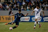 CARSON, CA - APRIL 12: Los Angeles Galaxy M Baggio Husidic #6 & Vancouver Whitecaps M Sebastian Fern