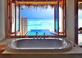 Luxury beautiful interior design on beach resort, window view from bathroom on clear blue sea, summe