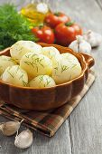 foto of saucepan  - Potatoes with dill in a saucepan on the table - JPG