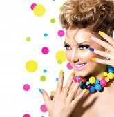 Beauty Girl Portrait with Colorful Makeup, Nail polish and Accessories. Studio Shot of Funny Woman. Vivid Colors. Colourful Manicure and fashion Hairstyle. Rainbow Colors. Beautiful lady make up