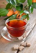 Tea And Branch Of Tangerines