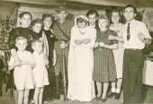 LODZ, POLAND, CIRCA 1950's: Vintage photo of newlyweds with family and guests