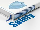 Protection concept: book Shield, Safety on white background