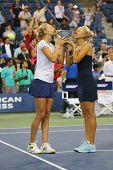 US Open 2014 women doubles champions Ekaterina Makarova and Elena Vesnina during trophy presentation
