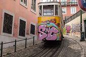 Yellow Tram In Lisbon Portugal Small Street