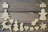 picture of ginger bread  - Frame of Ginger Bread Cookies on Wooden Planks as Winter Background with Copy Space - JPG