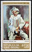 GUINEA - CIRCA 1981: A stamp printed in Republic of Guinea Bissau shows Pierrot Sitting