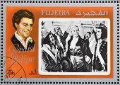 FUJEIRA - CIRCA 1972 : stamp printed in Fujeira shows actor Gerard Philipe circa 1972