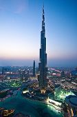 stock photo of dubai  - The Burj Khalifa illuminated by night in Dubai City - JPG