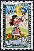 MONGOLIA - CIRCA 1977: stamp printed in Mongolia shows Girl chasing butterflies circa 1977