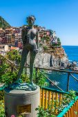 Ancient Sculpture And View Of Manarola.  La Spezia, Liguria, Northern Italy.