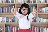 Beautiful Schoolgirl In Library