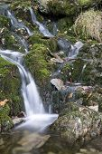 Waterfall Long Exposure Landscape Image In Summer In Forest Setting