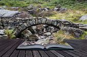 Old Ancient Packhorse Bridge Over Mountain Stream In Autumn Conceptual Book Image
