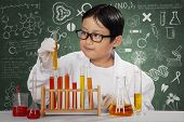 Little Scientist With Chemical In Laboratory