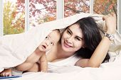 Lovely Baby And Mother On Bedroom