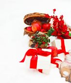 image of blanket snow  - Christmas still life with a Christmas decorations cookies and presents nestling in fresh snow  - JPG