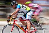 Colorful Motion Blur Pan Of Two Cyclists In Criterium Race