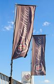 Samara, Russia - May 24, 2014: The Flags Of Cadillac Over Blue Sky. Cadillac Motor Car Division Is A